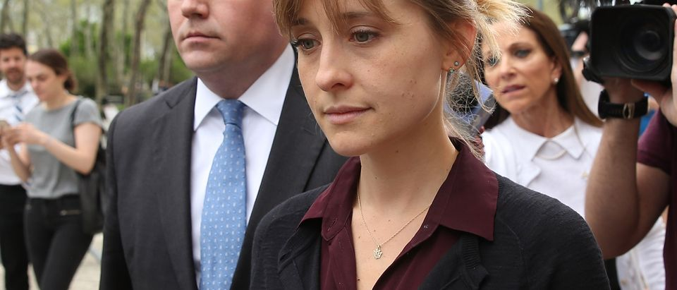 Actress Allison Mack (R) departs the United States Eastern District Court after a bail hearing in relation to the sex trafficking charges filed against her on May 4, 2018 in the Brooklyn borough of New York City. (Photo by Jemal Countess/Getty Images)