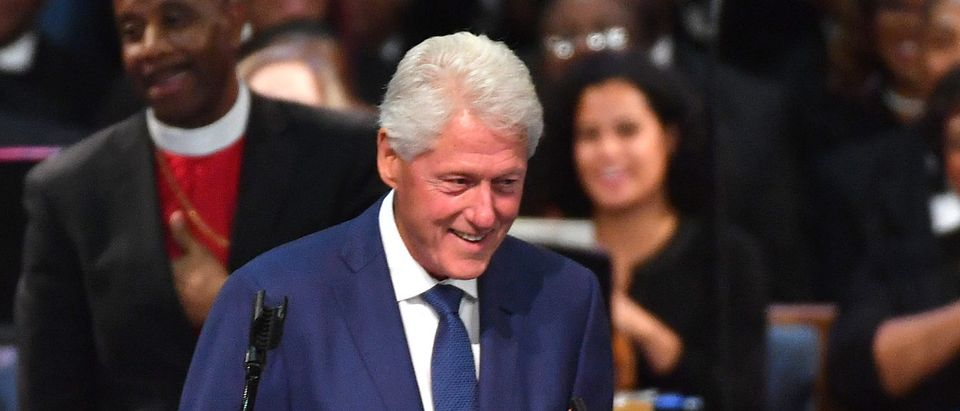 Former U.S. President Bill Clinton plays an Aretha Franklin song on his phone during Franklin's funeral at Greater Grace Temple on Aug. 31, 2018 in Detroit, Michigan. (ANGELA WEISS/AFP/Getty Images)