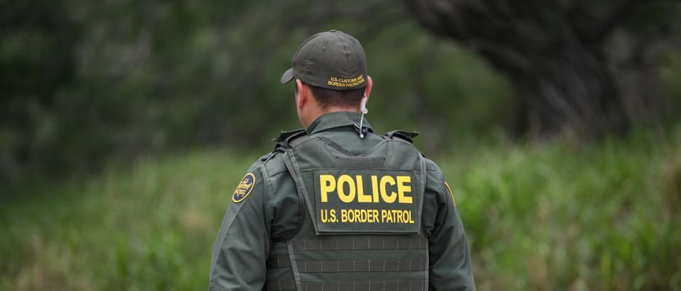 A U.S. Border Patrol agent is seen at the U.S.-Mexico border in Mission