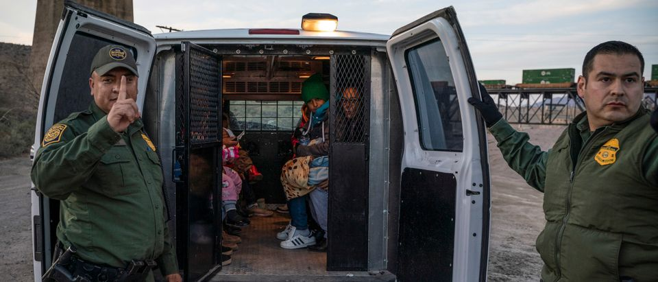 A group of about 30 Brazilian migrants, who had just crossed the border, get into a US Border Patrol van, taking them off the property of Jeff Allen, who used to run a brick factory near Mt. Christo Rey on the U.S.-Mexico border in Sunland Park, New Mexico on March 20, 2019. (Photo by Paul Ratje /AFP/Getty)
