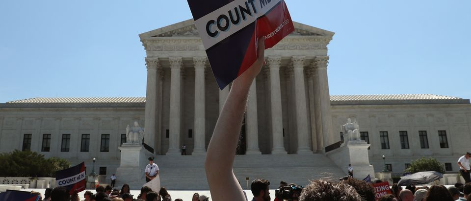 People gather in front of the Supreme Court after several decisions were handed down on June 27, 2019. (Mark Wilson/Getty Images)