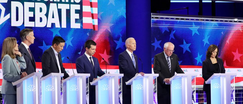 MIAMI, FLORIDA - JUNE 27: Democratic presidential candidates (L-R) Marianne Williamson, former Colorado governor John Hickenlooper, former tech executive Andrew Yang, South Bend, Indiana Mayor Pete Buttigieg, former Vice President Joe Biden, Sen. Bernie Sanders (I-VT), and Sen. Kamala Harris (D-CA) take part in the second night of the first Democratic presidential debate on June 27, 2019 in Miami, Florida. A field of 20 Democratic presidential candidates was split into two groups of 10 for the first debate of the 2020 election, taking place over two nights at Knight Concert Hall of the Adrienne Arsht Center for the Performing Arts of Miami-Dade County, hosted by NBC News, MSNBC, and Telemundo. (Photo by Drew Angerer/Getty Images)