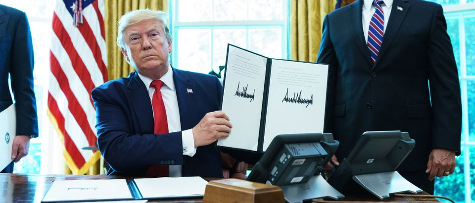 President Donald Trump shows an executive order on June 24, 2019. (Mandel Ngan/AFP/Getty Images)