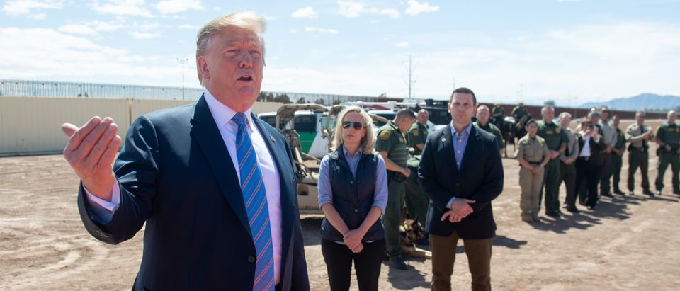 President Donald Trump speaks with members of the U.S. Customs and Border Patrol as he tours the border wall between the United States and Mexico on April 5, 2019. (Saul Loeb/AFP/Getty Images)