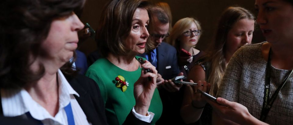 U.S. House Speaker Pelosi speaks to reporters as she walks to her office at the U.S. Capitol in Washington REUTERS/Jonathan Ernst - RC19FE5ECCD0