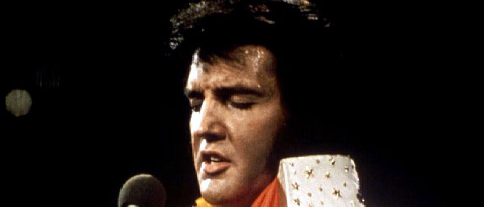 "FILE PHOTO 1972 - Elvis Presley performs in concert during his ""Aloha From Hawaii"" 1972 television special. January 8 marks what would have been Elvis's 60th birthday and fans are expected to gather in his home-town of Memphis for the occasion. REUTERS/Stringer"
