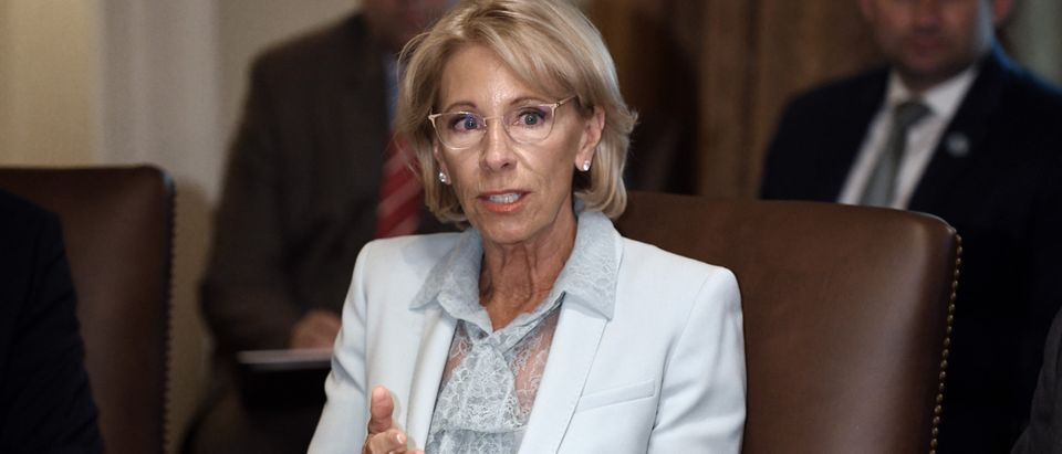 Secretary of Education Betsy DeVos speaks during a cabinet meeting with U.S. President Donald Trump in the Cabinet Room of the White House, July 18, 2018 in Washington, D.C. (Photo by Olivier Douliery-Pool/Getty Images)