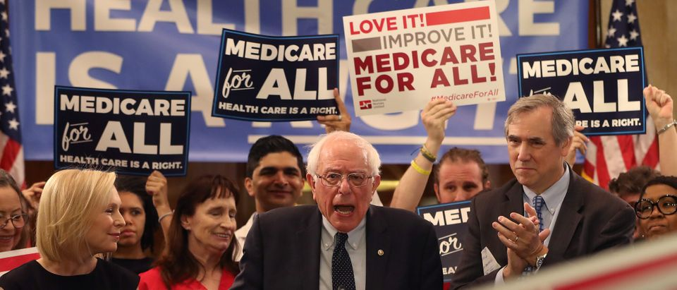 """Sen. Bernie Sanders speaks while introducing health care legislation titled the """"Medicare for All Act of 2019"""" with Sen. Kirsten Gillibrand and Sen. Jeff Merkley, during a news conference on Capitol Hill, on April 9, 2019 in Washington, DC. (Photo by Mark Wilson/Getty Images)"""