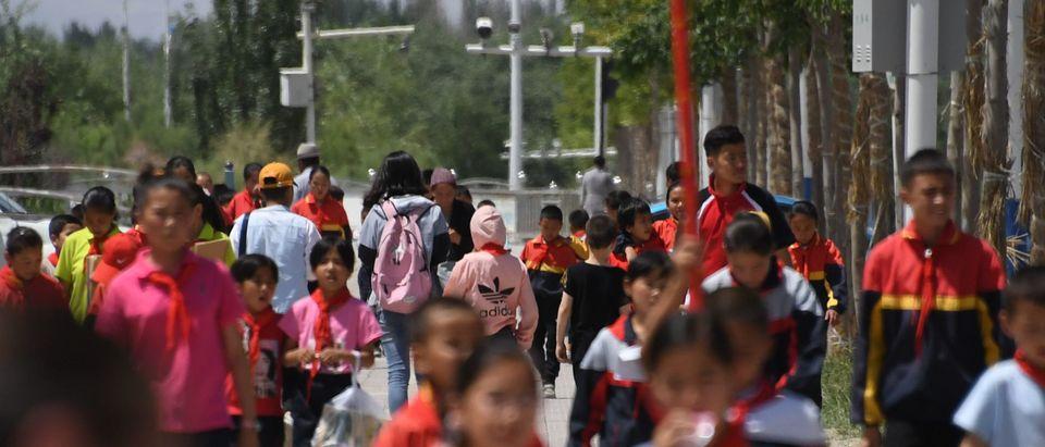 Schoolchildren Walking Below Surveillance Cameras In China (Photo by GREG BAKER/AFP/Getty Images)