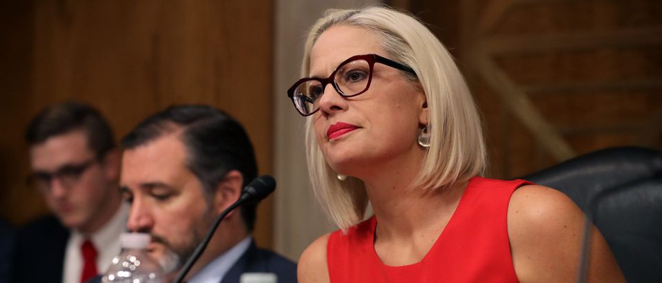 Senate Aviation and Space Subcommittee ranking member Sen. Kyrsten Sinema questions witnesses during a hearing in the Dirksen Senate Office Building on Capitol Hill. (Chip Somodevilla/Getty Images)