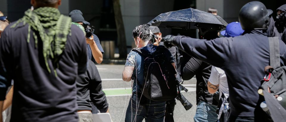Andy Ngo, a Portland-based journalist, is seen covered in an unknown substance after unidentified Rose City Antifa members attacked him on June 29, 2019 in Portland, Oregon. (Moriah Ratner/Getty Images)