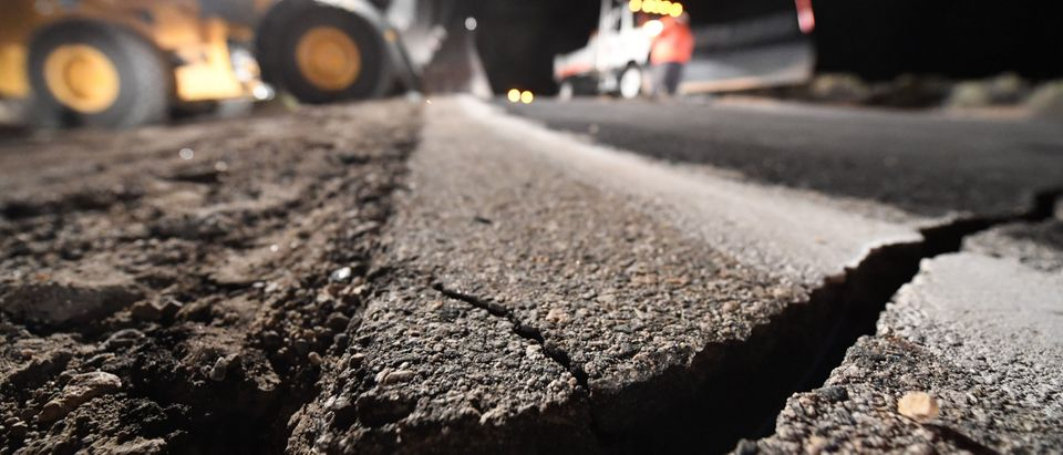 Highway workers repair a hole that opened in the road as a result of the July 5, 2019 earthquake, in Ridgecrest, California, about 150 miles (241km) north of Los Angeles, early in the morning on July 6, 2019. - Southern California was hit by its largest earthquake in two decades on July 5, a 7.1-magnitude tremor that rattled residents who were already reeling from another strong quake a day earlier. (Photo by Robyn Beck / AFP) (Photo credit should read ROBYN BECK/AFP/Getty Images)