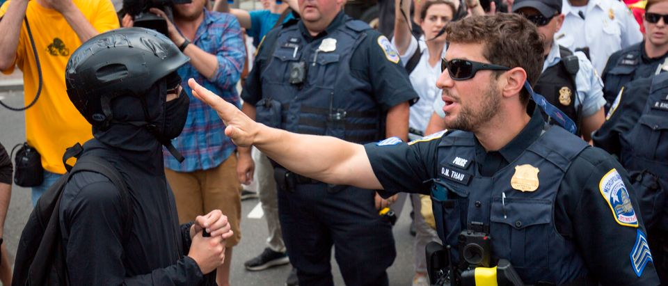 "A member of an anti-fascist or Antifa group (L) argues with police as they try to reach the Alt-Right ""Demand Free Speech"" rally in Washington, D.C., July 6, 2019. (Photo: ALASTAIR PIKE/AFP/Getty Images)"