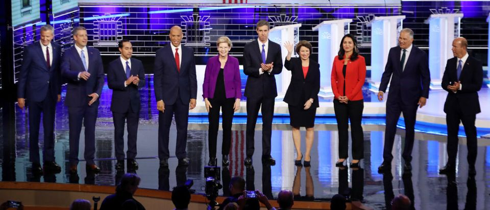 Democratic presidential candidates New York City Mayor Bill De Blasio (L-R), Rep. Tim Ryan (D-OH), former housing secretary Julian Castro, Sen. Cory Booker (D-NJ), Sen. Elizabeth Warren (D-MA), former Texas congressman Beto O'Rourke, Sen. Amy Klobuchar (D-MN), Rep. Tulsi Gabbard (D-HI), Washington Gov. Jay Inslee, and former Maryland congressman John Delaney take the stage during the first night of the Democratic presidential debate on June 26, 2019 in Miami, Florida. (Photo by Joe Raedle/Getty Images)