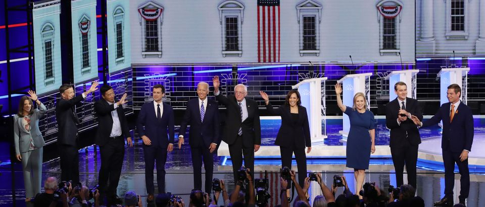 MIAMI, FLORIDA - JUNE 27: Democratic presidential candidates (L-R) Marianne Williamson, former Colorado governor John Hickenlooper, former tech executive Andrew Yang, South Bend, Indiana Mayor Pete Buttigieg, former Vice President Joe Biden, Sen. Bernie Sanders (I-VT), Sen. Kamala Harris (D-CA), Sen. Kirsten Gillibrand (D-NY), Sen. Michael Bennet (D-CO), and Rep. Eric Swalwell (D-CA) take the stage for the second night of the first Democratic presidential debate on June 27, 2019 in Miami, Florida. A field of 20 Democratic presidential candidates was split into two groups of 10 for the first debate of the 2020 election, taking place over two nights at Knight Concert Hall of the Adrienne Arsht Center for the Performing Arts of Miami-Dade County, hosted by NBC News, MSNBC, and Telemundo. (Photo by Drew Angerer/Getty Images)