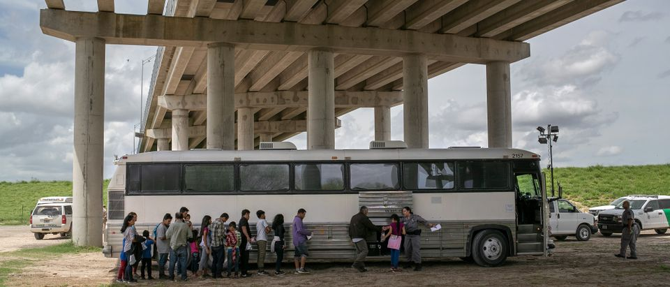 U.S. Border Patrol agents transport immigrants seeking asylum in McAllen, Texas. (Photo by John Moore/Getty Images)