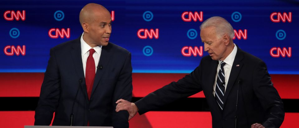 Democratic presidential candidate Sen. Cory Booker (L) and former Vice President Joe Biden speak during the Democratic Presidential Debate at the Fox Theatre July 31, 2019 in Detroit, Michigan. (Photo by Scott Olson/Getty Images)