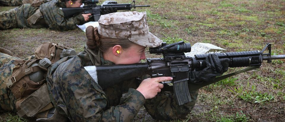 Female Marine recruits fire on the rifle range during boot camp February 25, 2013 at MCRD Parris Island, South Carolina. (Photo by Scott Olson/Getty Images)