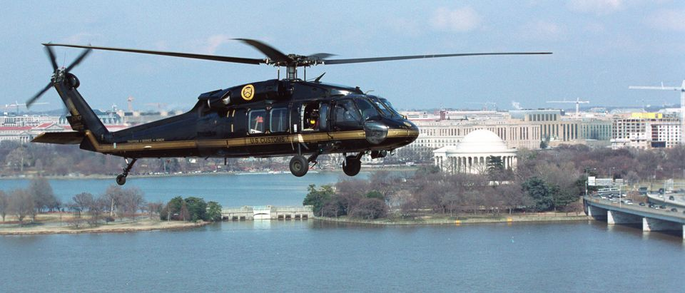 A U.S. Customs and Border Protection Black Hawk helicopter provides air security March 18, 2003 as it flies over Washington, DC. (James Tourtellotte/U.S. Customs/Getty Images)