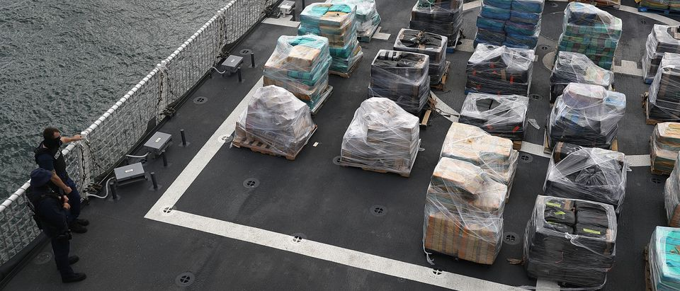 U.S. Coast Guard security personnel watch over 26.5 tons of cocaine at Port Everglades in Fort Lauderdale, Florida. (Photo by Joe Raedle/Getty Images)
