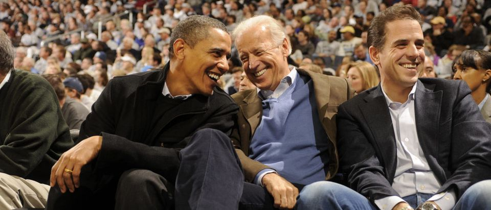 President of the United States Barack Obama and Vice President Joe Biden and Hunter Biden (son of Joe Biden) talk during a college basketball game between Georgetown Hoyas and the Duke Blue Devils on January 30, 2010 at the Verizon Center in Washington DC. (Mitchell Layton/Getty Images)