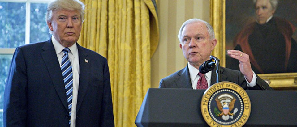 Jeff Sessions, U.S. attorney general, speaks as U.S. President Donald Trump, left, listens after Sessions was sworn in by U.S. Vice President Mike Pence, not pictured, in the Oval Office of the White House in Washington, D.C