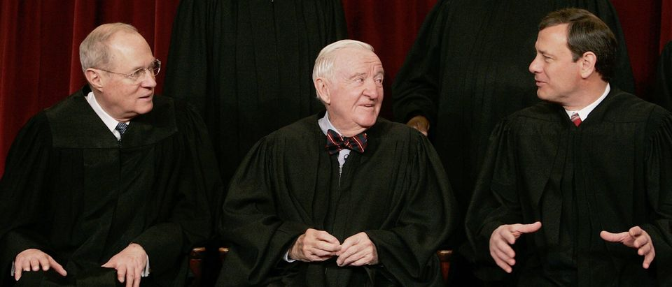 (L to R) Justice Anthony Kennedy, Justice John Paul Stevens, and Chief Justice John Roberts chat during a photo session on March 3, 2006. (Mark Wilson/Getty Images)