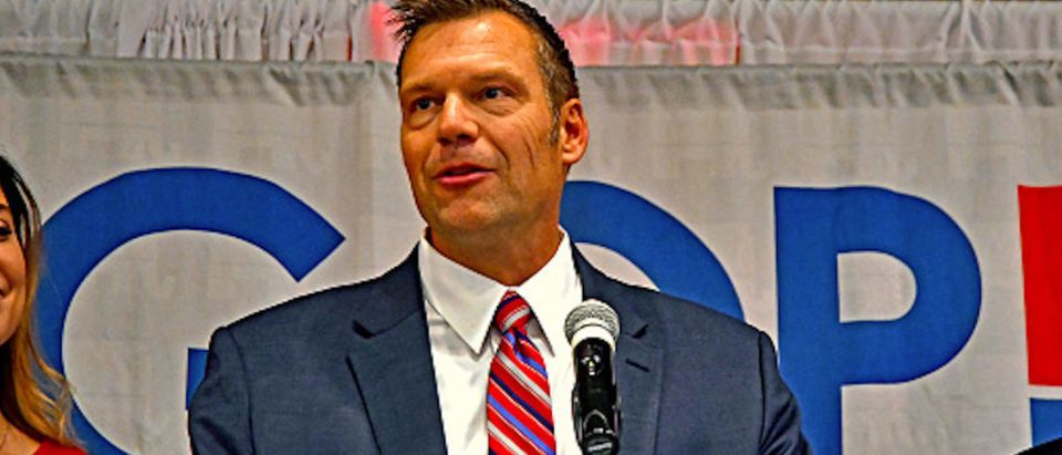 Kansas Secretary of State Kris Kobach, with his wife Heather by his side, gives his concession in Topeka, Kansas, November 6, 2018