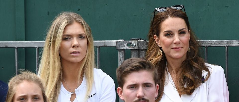 Britain's Catherine, Duchess of Cambridge (R) is seen on Court 14 as she watches Britain's Harriet Dart playing against US player Christina McHale at The All England Tennis Club in Wimbledon, southwest London, on July 2, 2019, on the second day of the 2019 Wimbledon Championships tennis tournament. (Photo credit: GLYN KIRK/AFP/Getty Images)