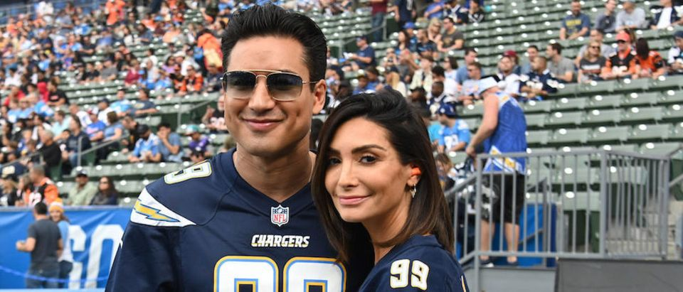 Dec 9, 2018; Carson, CA, USA; Television personality Mario Lopez (left) and wife Courtney Lopez pose during the NFL game between the Cincinnati Bengals and the Los Angeles Chargers at StubHub Center. Mandatory Credit: Kirby Lee-USA TODAY Sports-Reuters