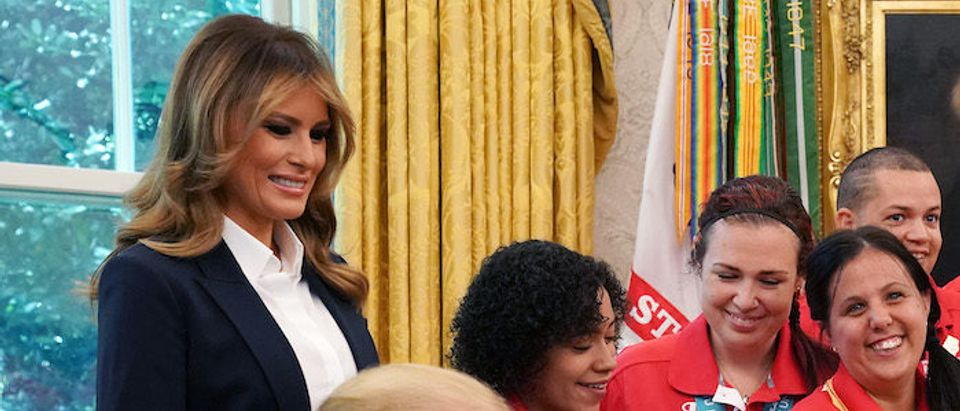 U.S. President Donald Trump congratulates USA Special Olympics gold medalist Delina Rodrigues while hosting her and members of the United States Special Olympics World Games team with first lady Melania Trump in the Oval Office at the White House July 18, 2019 in Washington, DC. During the photo opportunity, Trump said that he wished his supporters had not chanted, 'Send her back,' in reference to Rep. Ilhan Omar (D-MN) during a political rally Wednesday in North Carolina. (Photo by Chip Somodevilla/Getty Images)