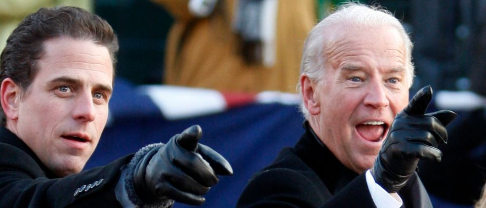 U.S. Vice President Joe Biden (R) points to some faces in the crowd with his son Hunter as they walk down Pennsylvania Avenue following the inauguration ceremony of President Barack Obama in Washington, January 20, 2009. Obama became the first black U.S. president on Tuesday and quickly turned the page on the Bush years, urging Americans to rally together to end the worst economic crisis in 70 years and repair the U.S. image abroad. REUTERS/Carlos Barria