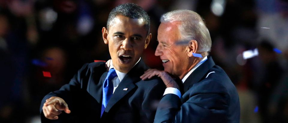 U.S. President Barack Obama gestures with Vice President Joe Biden after his election night victory speech in Chicago, November 6, 2012. REUTERS/Larry Downing (UNITED STATES - Tags: POLITICS TPX IMAGES OF THE DAY USA PRESIDENTIAL ELECTION ELECTIONS)