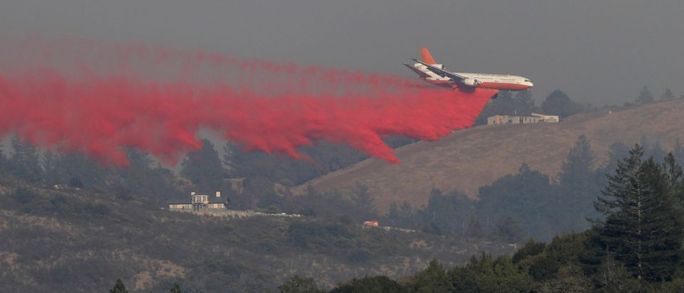 An air tanker drops retardant to contain a wildfire outside Santa Rosa
