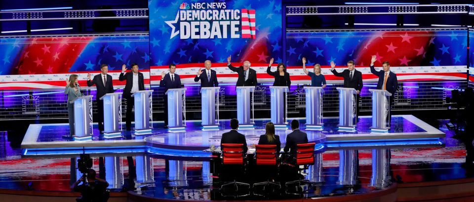 Candidates raise hands during the second night of the first U.S. 2020 presidential election Democratic candidates debate in Miami, Florida, U.S.
