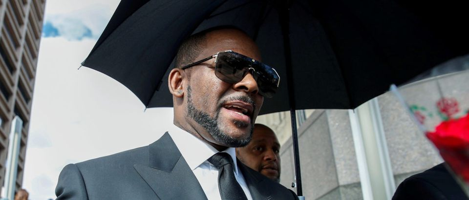 FILE PHOTO: Grammy-winning R&B star R. Kelly leaves the Cook County courthouse in Chicago