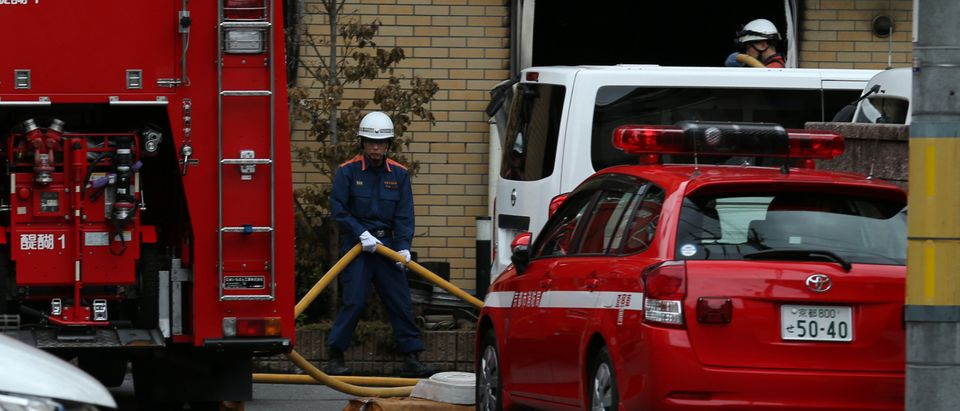 Firefighter works the scene where over 30 people died in a fire at the Kyoto Animation company building in Kyoto on July 19, 2019. - Details emerged July 19 of a horrifying inferno that tore through a Japanese animation firm and killed dozens, with people jumping out of the three-storey building and others trapped in a staircase unable to escape. Photo by BUDDHIKA WEERASINGHE/AFP/Getty Images