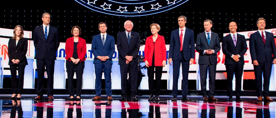 Democratic presidential hopefuls (L-R) US author and writer Marianne Williamson, US Representative for Ohio's 13th congressional district Tim Ryan, US Senator from Minnesota Amy Klobuchar, Mayor of South Bend, Indiana, Pete Buttigieg, US senator from Vermont Bernie Sanders, US Senator from Massachusetts Elizabeth Warren, US Representative for Texas' 16th congressional district Beto O'Rourke, Former Governor of Colorado John Hickenlooper, former US Representative for Maryland's 6th congressional district John Delaney and Governor of Montana Steve Bullock stand onstage ahead of the first round of the second Democratic primary debate of the 2020 presidential campaign season hosted by CNN at the Fox Theatre in Detroit, Michigan on July 30, 2019. (Photo by JIM WATSON/AFP/Getty Images)