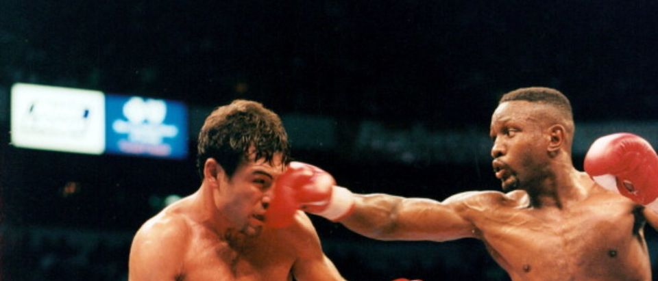 LAS VEGAS - APRIL 12,1997: Oscar De La Hoya (L) is hit with a right punch from Pernell Whitaker during the fight at Thomas & Mack Center,on April 12,1997 in Las Vegas, Nevada.Oscar De La Hoya won the WBC welterweight title by a UD 12. (Photo by: The Ring Magazine via Getty Images)