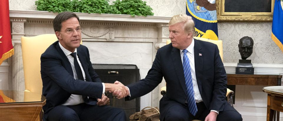 FILE: Mark Rutte, Netherland's prime minister, shakes hands with U.S. President Donald Trump, right, during a meeting at the White House in Washington, D.C., U.S., on Monday, July 2, 2018. Donald Trump and Vladimir Putin will meet in Helsinki, Finland, on July 16 for their first bilateral summit as the leaders seek to reverse a downward spiral in relations that has been exacerbated by findings that Russia meddled in U.S. elections. Our editors select a set of archive images of U.S. President Donald Trump ahead of the summit meeting. Photographer: Chris Kleponis/Pool via Bloomberg