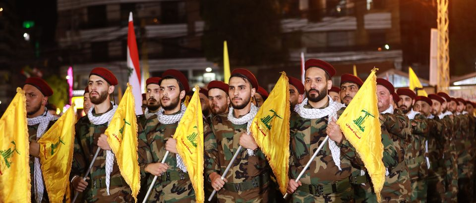 Fighters with the Lebanese Shiite Hezbollah party, carry flags as they parade in a southern suburb of the capital Beirut, to mark the al-Quds (Jerusalem) International Day, on May 31, 2019. (ANWAR AMRO/AFP/Getty Images)