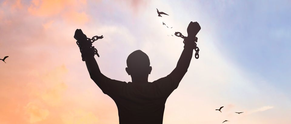 A man is freed from shackles. Shutterstock image via Jacob_09