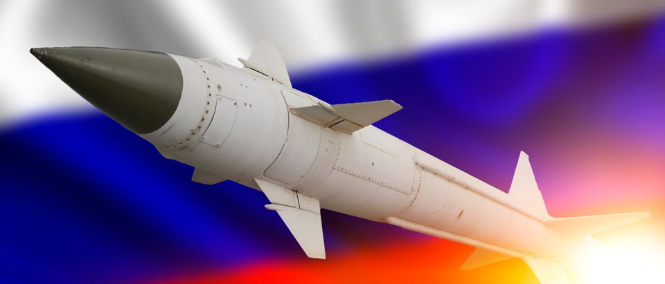 Russian missile and flag. SHUTTSTOCK/gerasimov_foto_174)