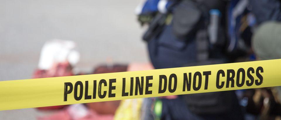 Law enforcement responds to a shooting. Shutterstock image via Prath