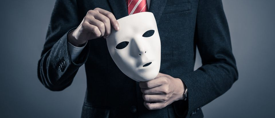 Mask and businessman (Photo: Shutterstock)