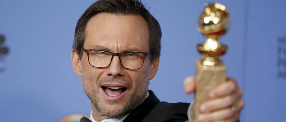 """Christian Slater poses backstage with the award for Best Performance by an Actor in a Supporting Role in a Series, Limited Series or Motion Picture Made for Television for his role in """"Mr. Robot"""" at the 73rd Golden Globe Awards in Beverly Hills, California, January 10, 2016. REUTERS/Lucy Nicholson"""
