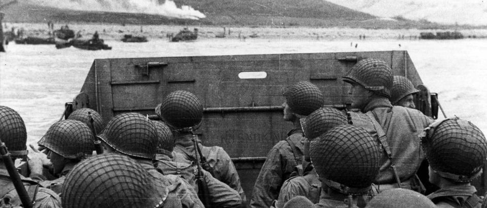 """U.S. Army troops in an LCVP landing craft approach """"Omaha"""" Beach on D-Day in Colleville Sur-Mer"""