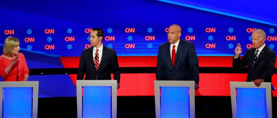 U.S. Senator Kirsten Gillibrand talks to former Vice President Joe Biden (R) past former HUD Secretary Julian Castro (2nd L) and U.S. Senator Cory Booker (2nd R) on the second night of the second 2020 Democratic U.S. presidential debate in Detroit, Michigan, July 31, 2019. REUTERS/Lucas Jackson