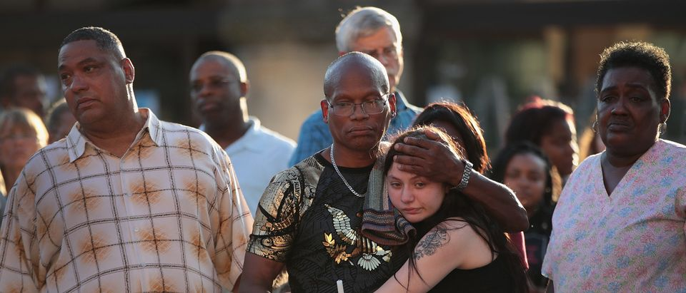 Roderick Fudge comforts his granddaughter during a memorial service to remember the victims of Sunday morning's mass shooting in the Oregon District of nearby Dayton on Aug. 5, 2019 in Springfield, Ohio. (Photo by Scott Olson/Getty Images)