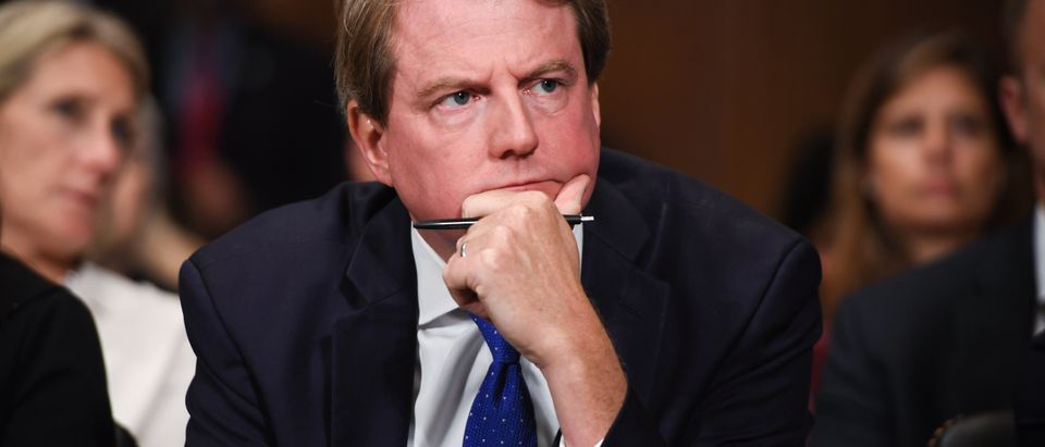 Former White House counsel Donald McGahn listens as Justice Brett Kavanaugh testifies before the Senate Judiciary Committee on Sept. 27, 2018. (Saul Loeb/Pool/Getty Images)